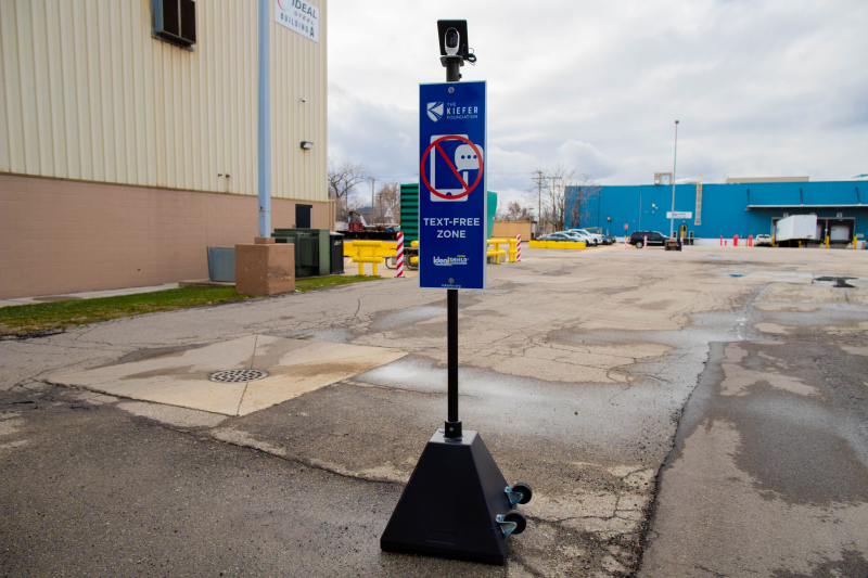 Ideal Shield's Pyramid Sign Base with Wheels, Custom Signage, and Camera