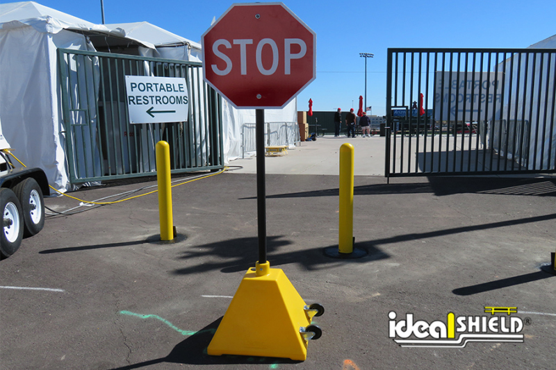 Ideal Shield's Pyramid Sign Base with Wheels and a Standard Stop Sign