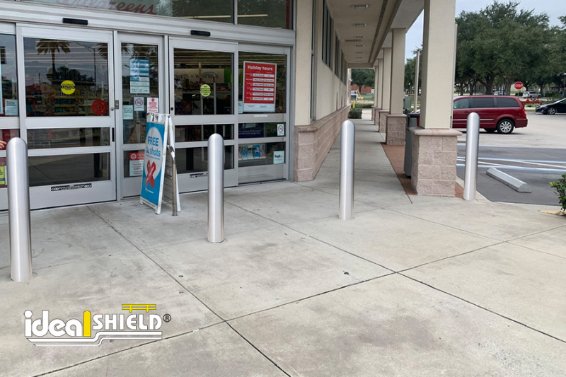 Ideal Shield's Stainless Steel Bollard Cover at a store entrance