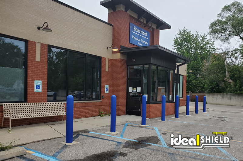 Ideal Shield's Super Saver Bollards installed in a parking lot
