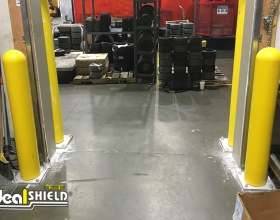 """Ideal Shield's 1/4"""" Bollard Covers on base plate bollards used to guard a dock door"""