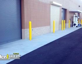 "1/8"" Bollard Sleeves Protecting Garage Doors"