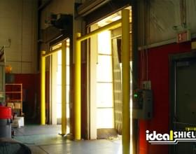 Two of Ideal Shield's yellow Goal Post Dock Door protection systems