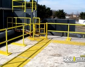 Yellow Roof Rail Fall Protection With Gated Entry