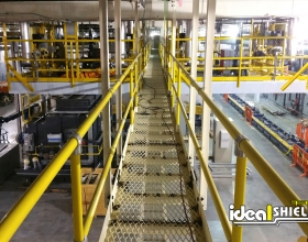 Ideal Shield's yellow Steel Pipe and Plastic handrail lining warehouse walkway