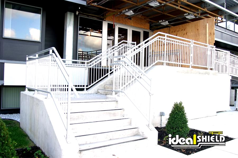 Ideal Shield aluminum handrail on a stairway