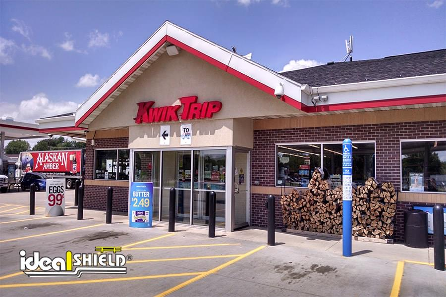 Black standard bollard covers and custom accessible blue bollard covers at Kwik Trip