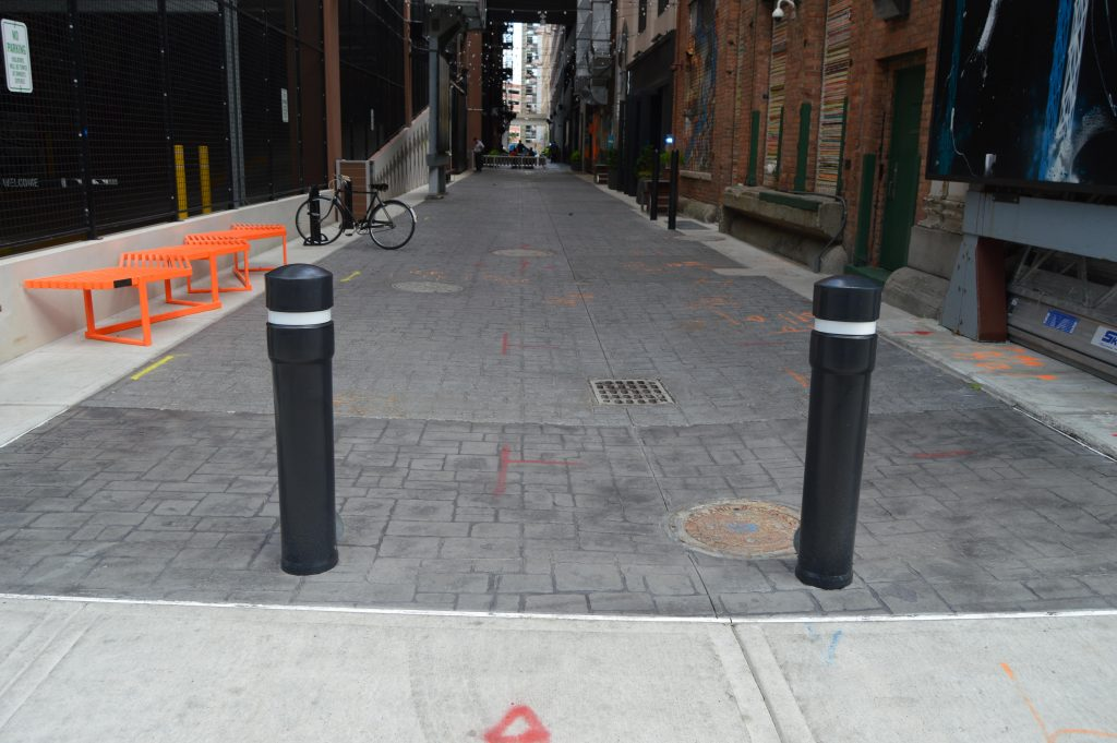 Ideal Shield's Removable Locking Bollards at the Z-Lot Alley
