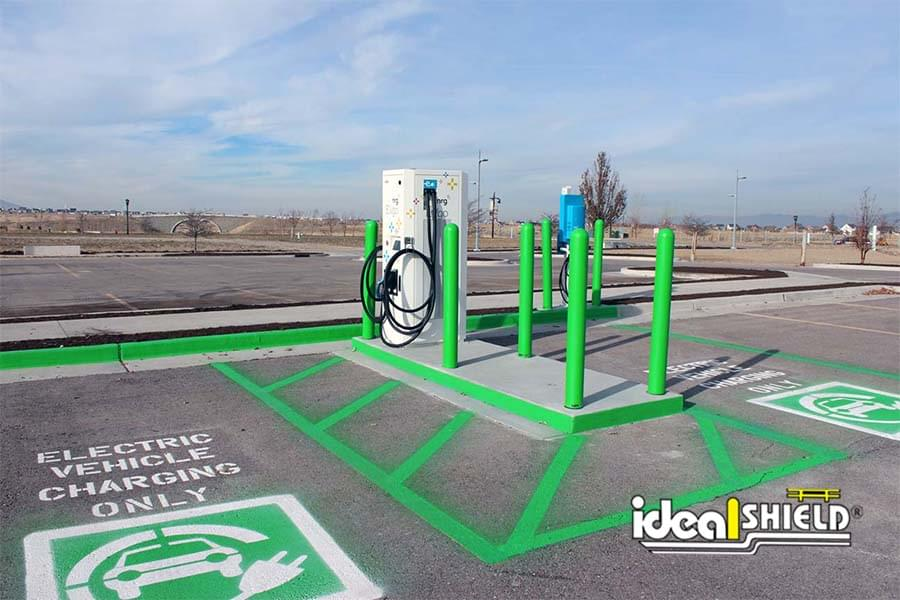 Ideal Shield's lime green bollard covers around an electric vehicle charging station