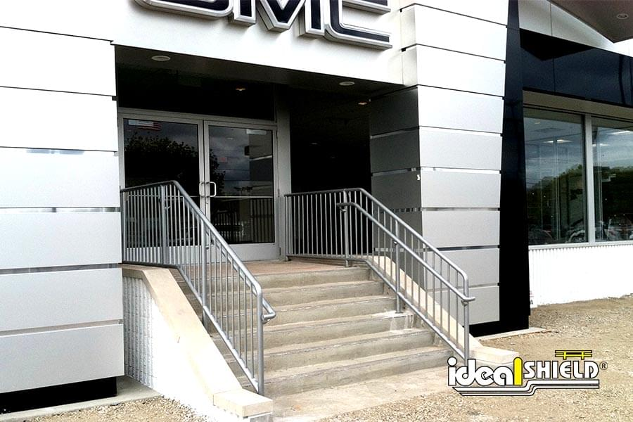 Ideal Shield's aluminum handrail at the entrance of a GMC dealership