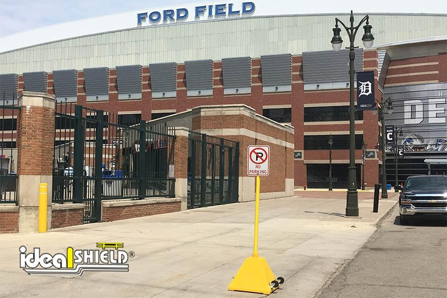 Ideal Shield's yellow plastic portable sign base outside of Comerica Park and Ford Field in Detroit, MI