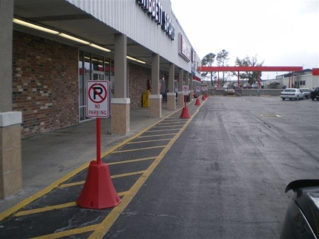 Ideal Shield's red plastic octagon sign base in a no-parking zone