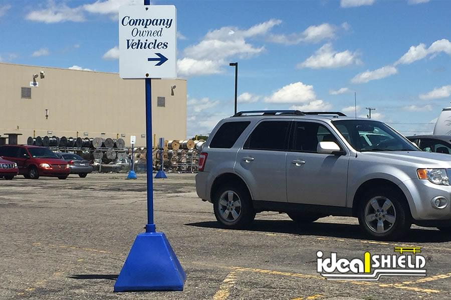 Ideal Shield's blue plastic Pyramid Sign Base used for parking lot directions