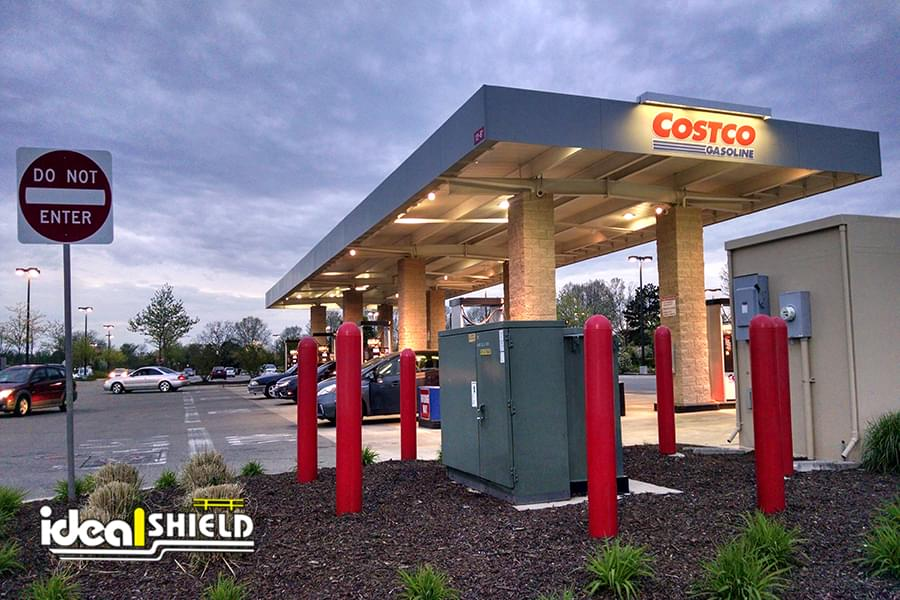 Ideal Shield's red bollard covers used to protect an electrical box at a Costco gas station