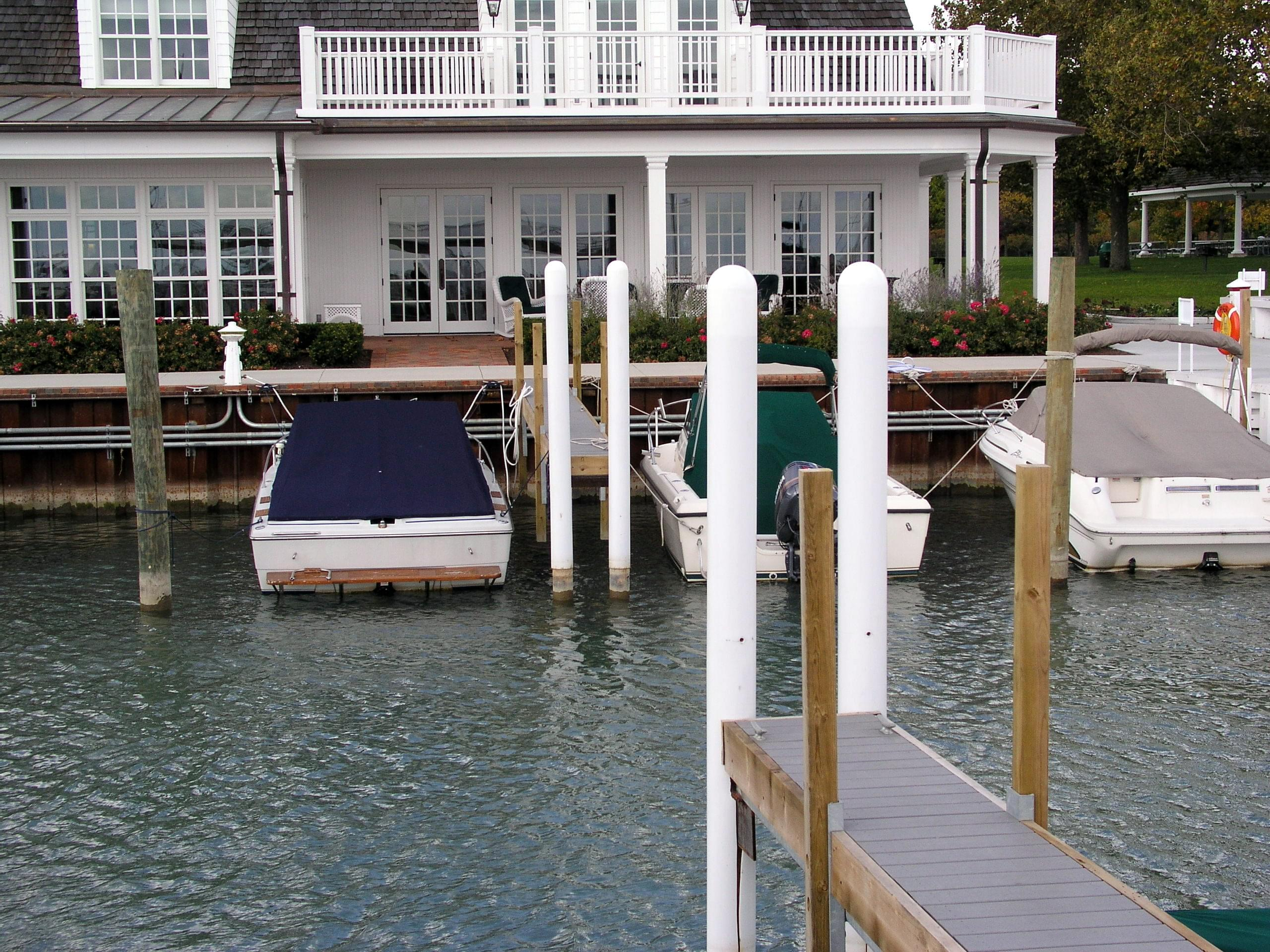 Ideal Shield's white bollard covers used for marina boat dock protection