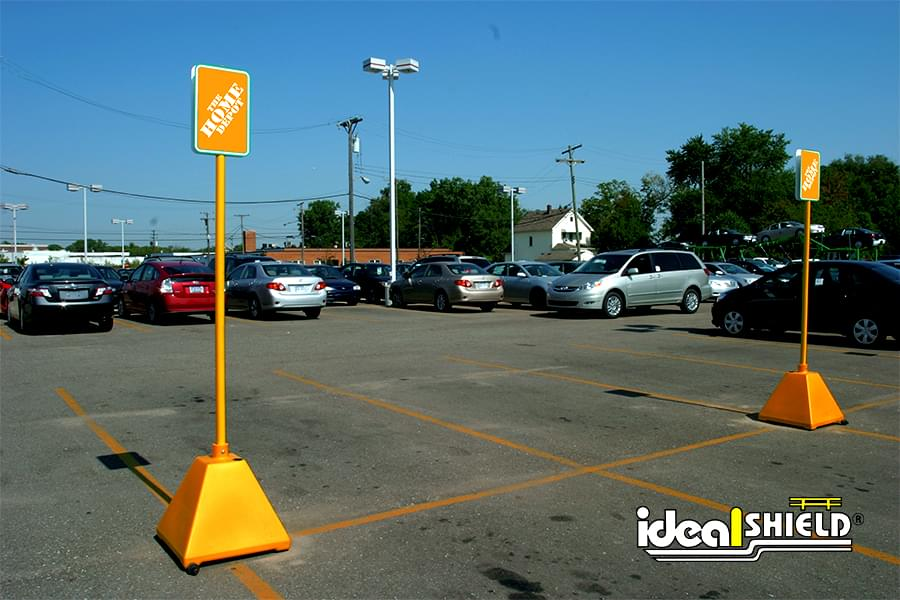 Custom orange sign bases for designated parking at Home Depot