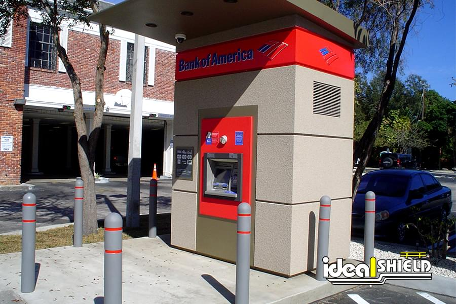 Bollard Covers with red reflective striping guarding a Bank of America ATM kiosk