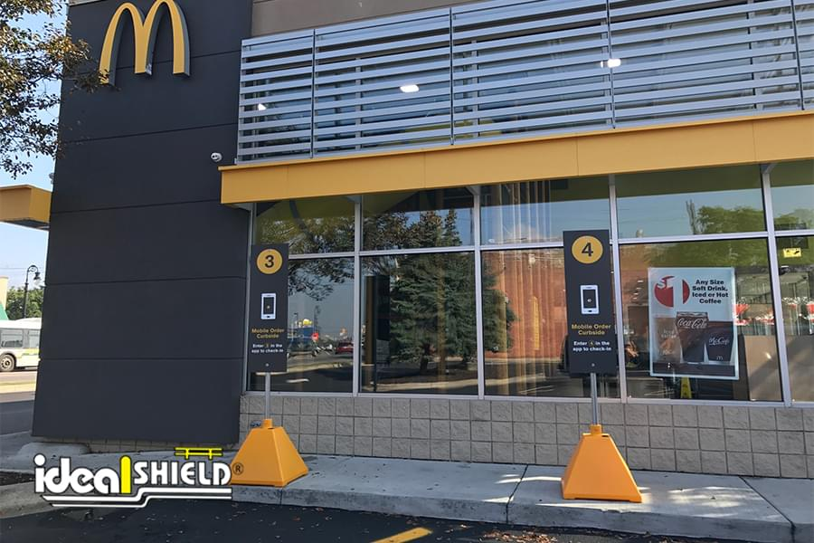 Dollar Gold sign bases for McDonald's curbside pickup parking