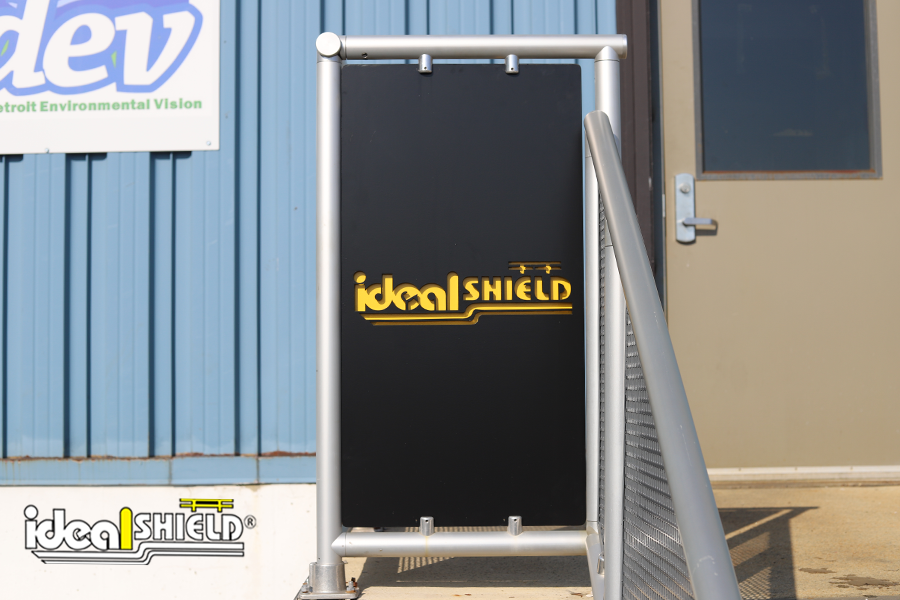 Custom infill panels for aluminum handrail with Ideal Shield's logo