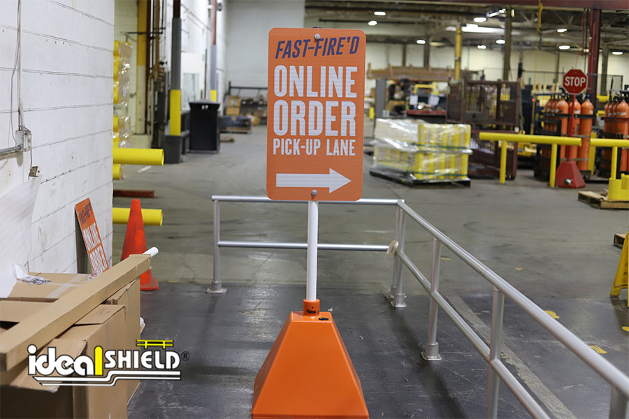 Ideal Shield's Orange Sign Base with white pole and custom signage for Blaze Pizza's curbside pickup