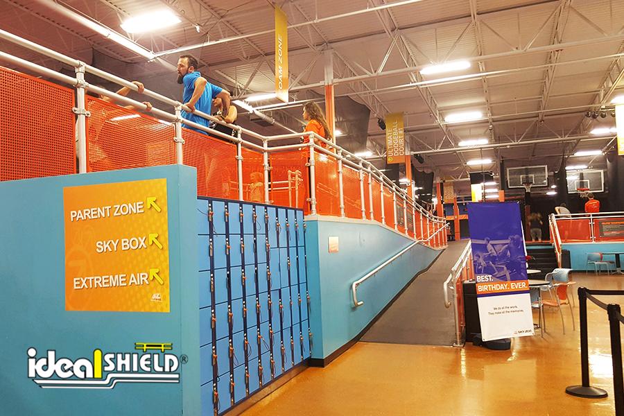 Ideal Shield's Aluminum Handrail with Orange Infill panels around SkyZone Trampoline Park