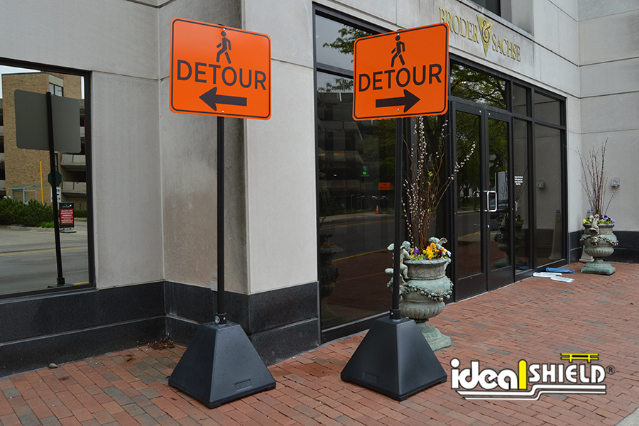 Ideal Shield's Black Pyramid Sign Bases used for pedestrian traffic control