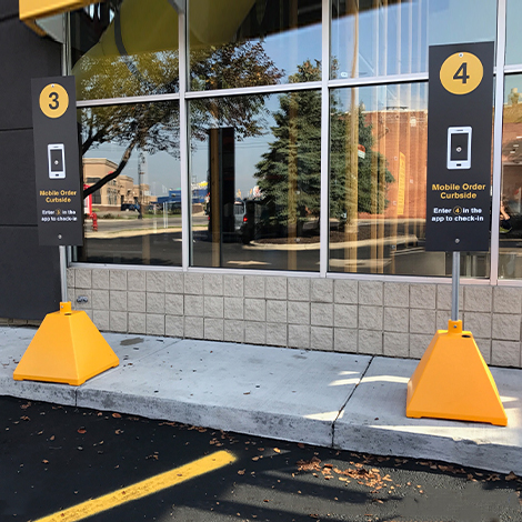 Ideal Shield's curbside pickup sign bases for McDonald's
