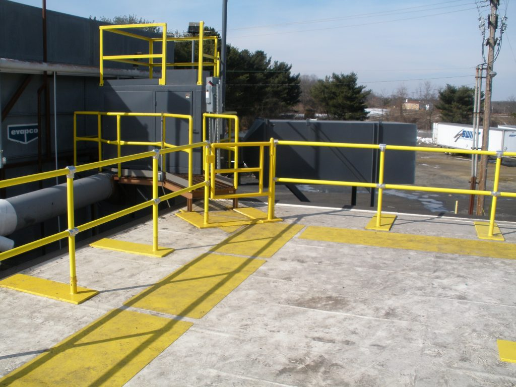 Ideal Shield's Roof Fall Protection Railing with base plates and custom gates