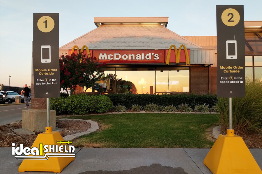 Ideal Shield's Pyramid Sign Bases in custom Dollar Gold for McDonald's Drive Thru and Curbside Services