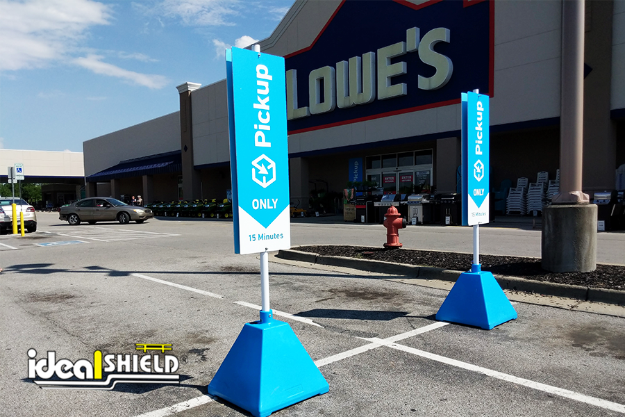 Ideal Shield's Pyramid Sign Bases in custom Carolina Blue for Lowe's Curbside Pickup Services