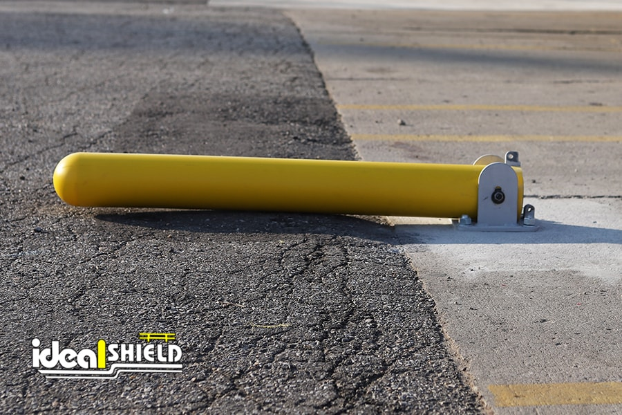 Ideal Shield's Collapsible Bollard with Bollard Cover grounded