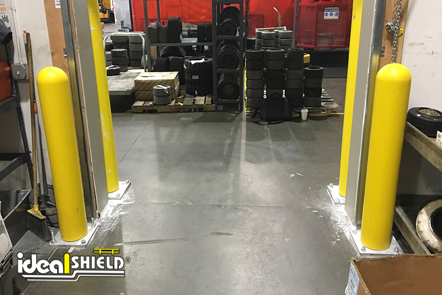 Ideal Shield's Base Plate Bollards used to protect overhead door tracks