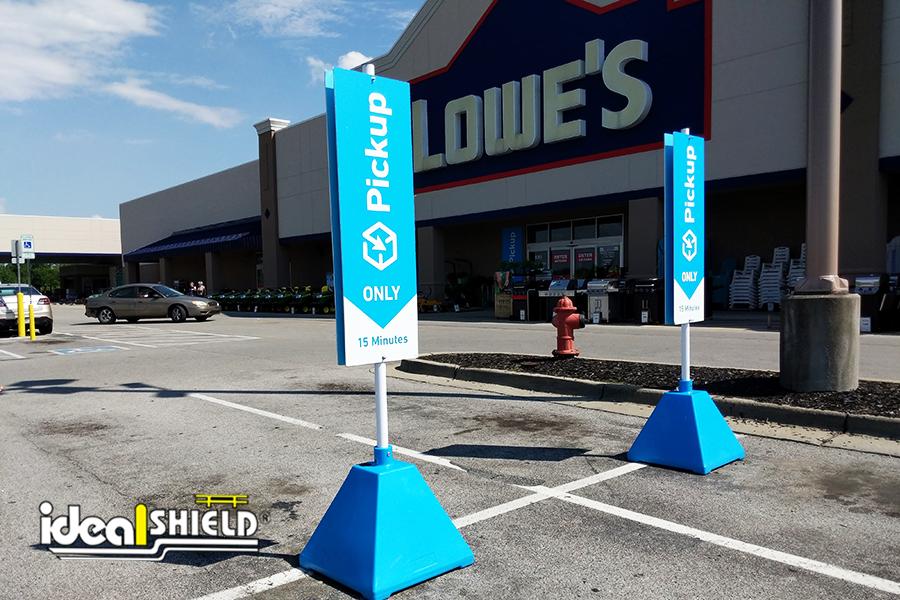 Ideal Shield's custom Carolina Blue Pyramid Sign Base Systems at Lowe's Curbside Pickup